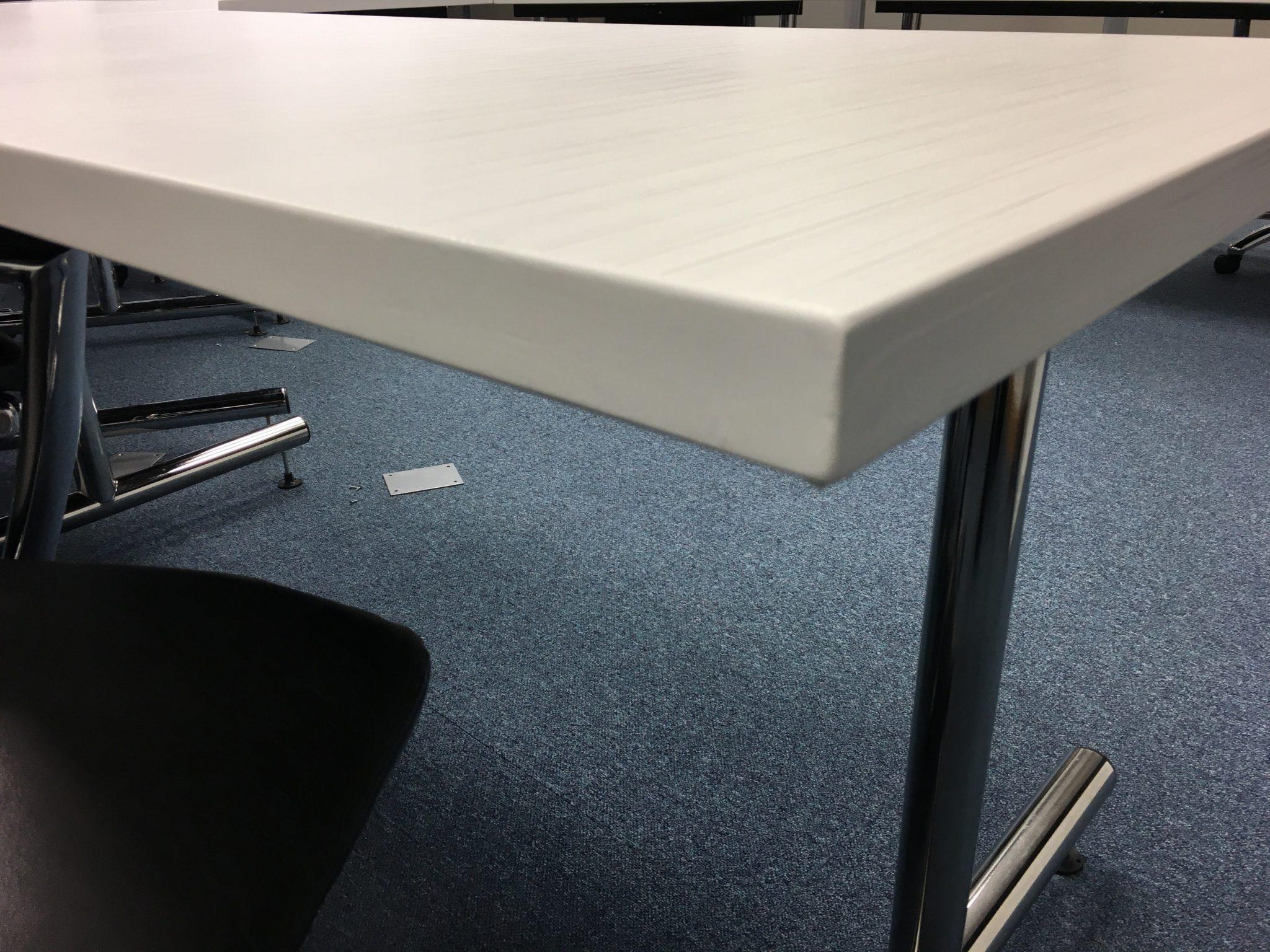 Table corner vinyl wrapped